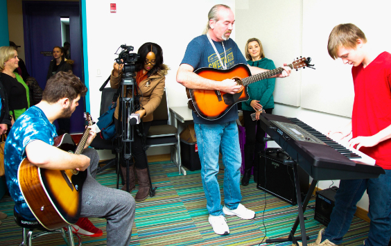 Jam session students with instructor