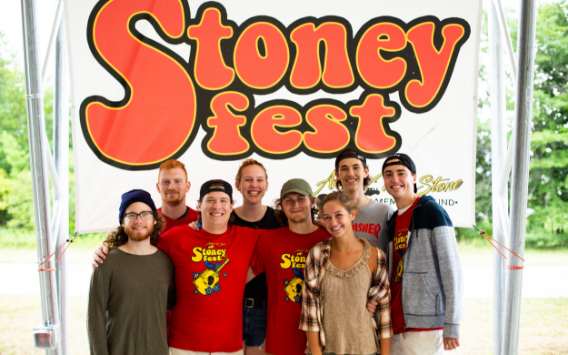 Group of teenagers in front of StonyFest banner